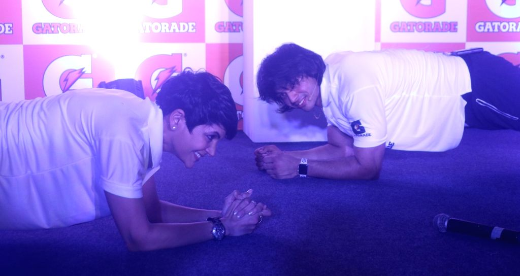Actress Mandira Bedi and Javelin thrower Neeraj Chopra who bagged a gold and two silvers at the 18th Asian Games; during a promotional programme, in New Delhi on Sept 11, 2018. - Mandira Bedi and Neeraj Chopra