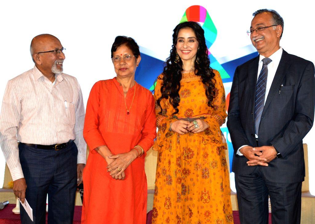 Actress Manisha Koirala interacts with cancer survivors during a programme at a Bengaluru hospital on Feb 4, 2019. - Manisha Koirala