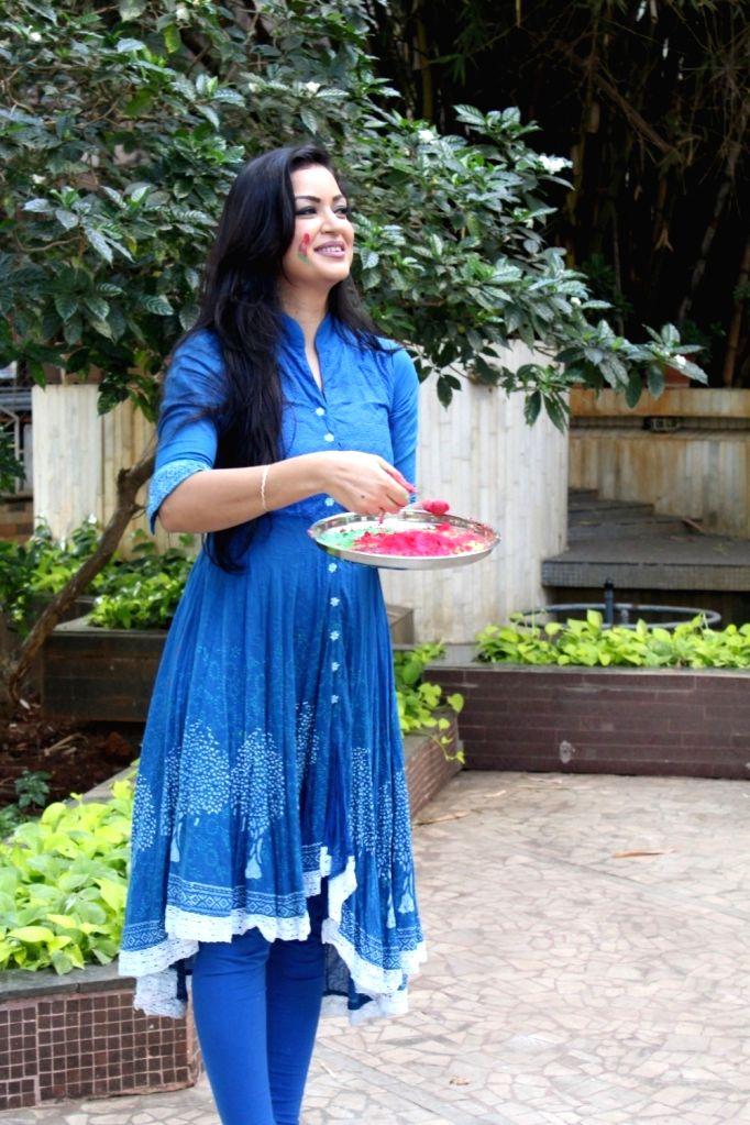 Actress Maryam Zakaria poses during the Holi celebration photo shoot in Mumbai on March 10, 2017. - Maryam Zakaria