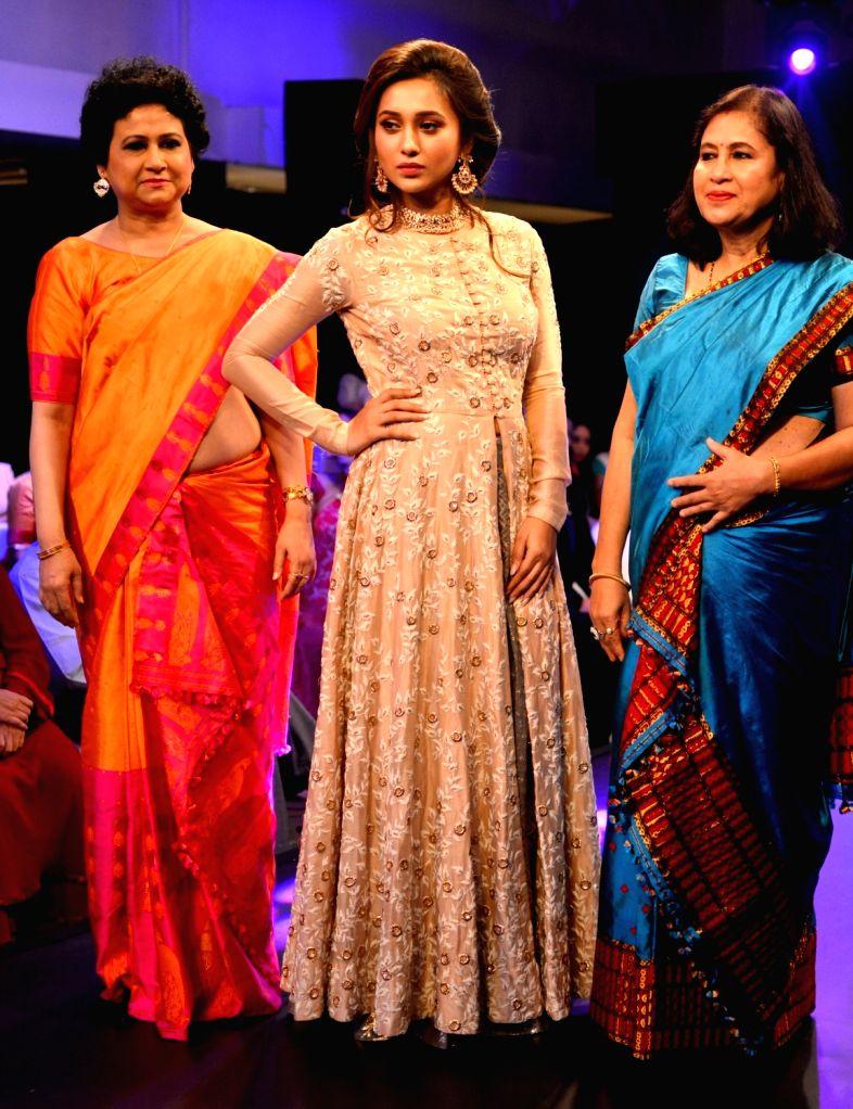 Actress Mimi Chakraborty walks the ramp during Breast Cancer Awareness campaign in Kolkata on Sept 7, 2017. - Mimi Chakraborty