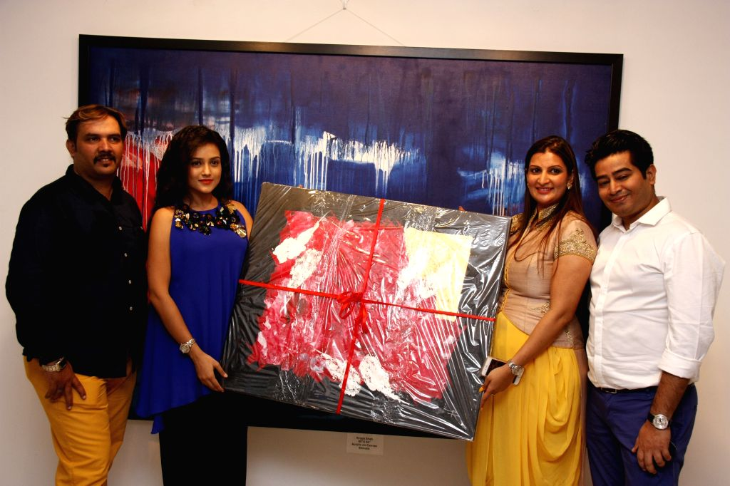 Actress Mishti Chakraborty during the inauguration of artist Krupa Shah (R) painting exhibition, in Mumbai, on Aug 17, 2015. - Krupa Shah