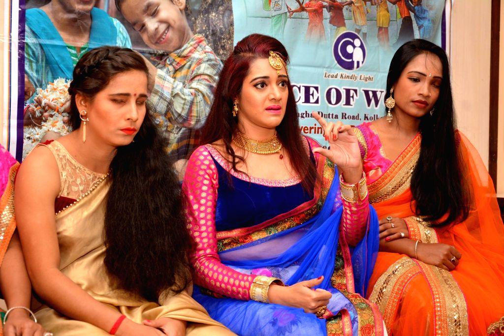 Actress Moubani Sorcar along with visually impaired women during a promotional programme in Kolkata on Feb 13, 2018. - Moubani Sorcar