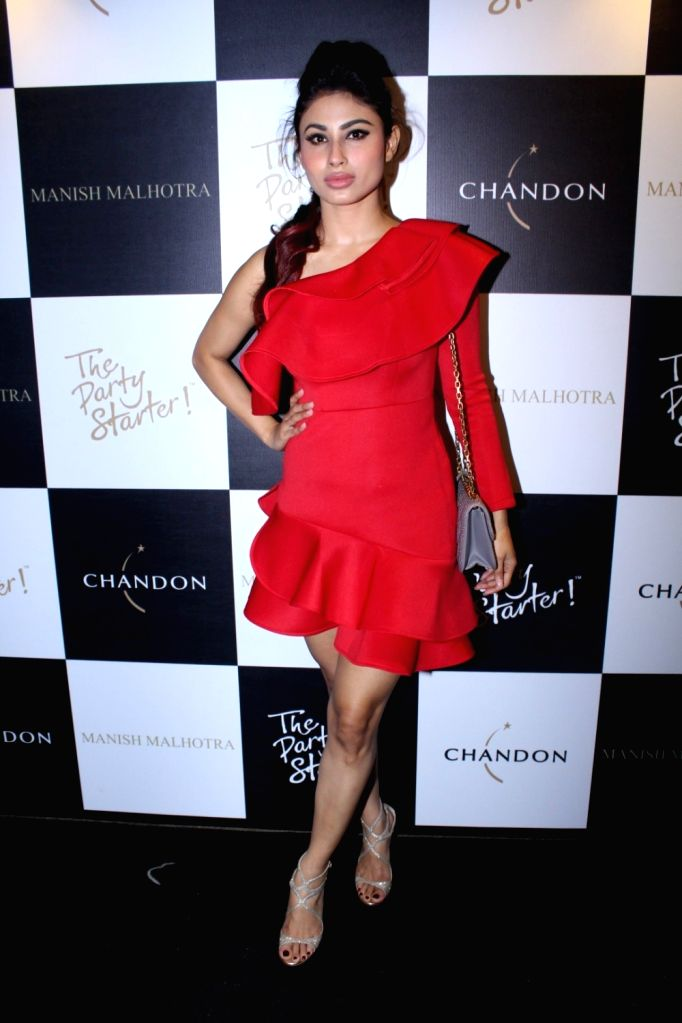 Actress Mouni Roy during the launch of Manish Malhotra X Chandon Champagne bottles Limited Edition End Of Year 2017 in Mumbai on Oct 9, 2017. - Mouni Roy