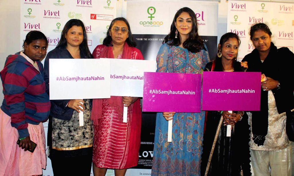 Actress Mrunal Thakur with sex workers during special screening of her upcoming film 'Love Sonia' in Kolkata on Jan 11, 2019. - Mrunal Thakur