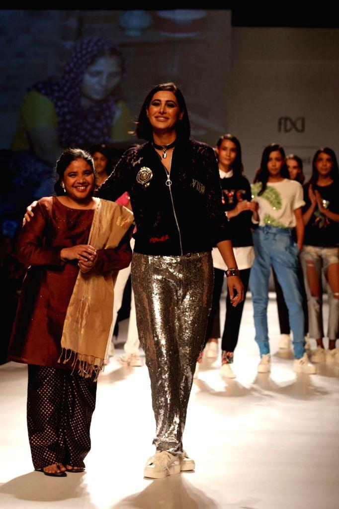 Actress Nargis Fakhri walks the ramp  at Amazon India Fashion Week Summer Spring in New Delhi, on Oct 11, 2017. - Nargis Fakhri