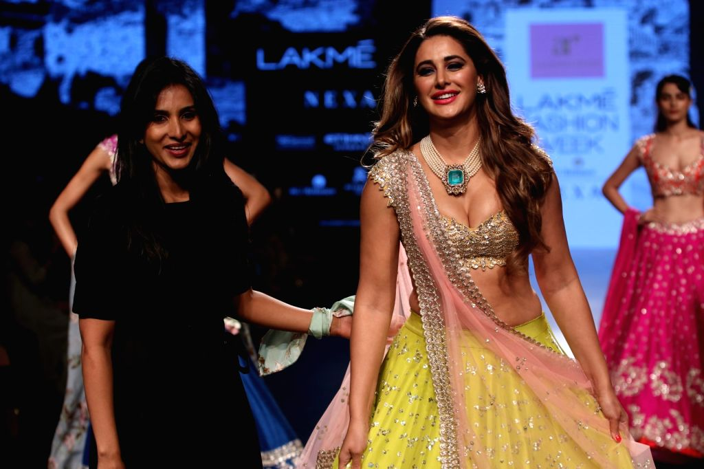 Actress Nargis Fakhri walks the ramp for fashion designer Anushree Reddy during the Lakme Fashion Week Winter/Festive 2017 in Mumbai on Aug 19, 2017. - Nargis Fakhri and Anushree Reddy