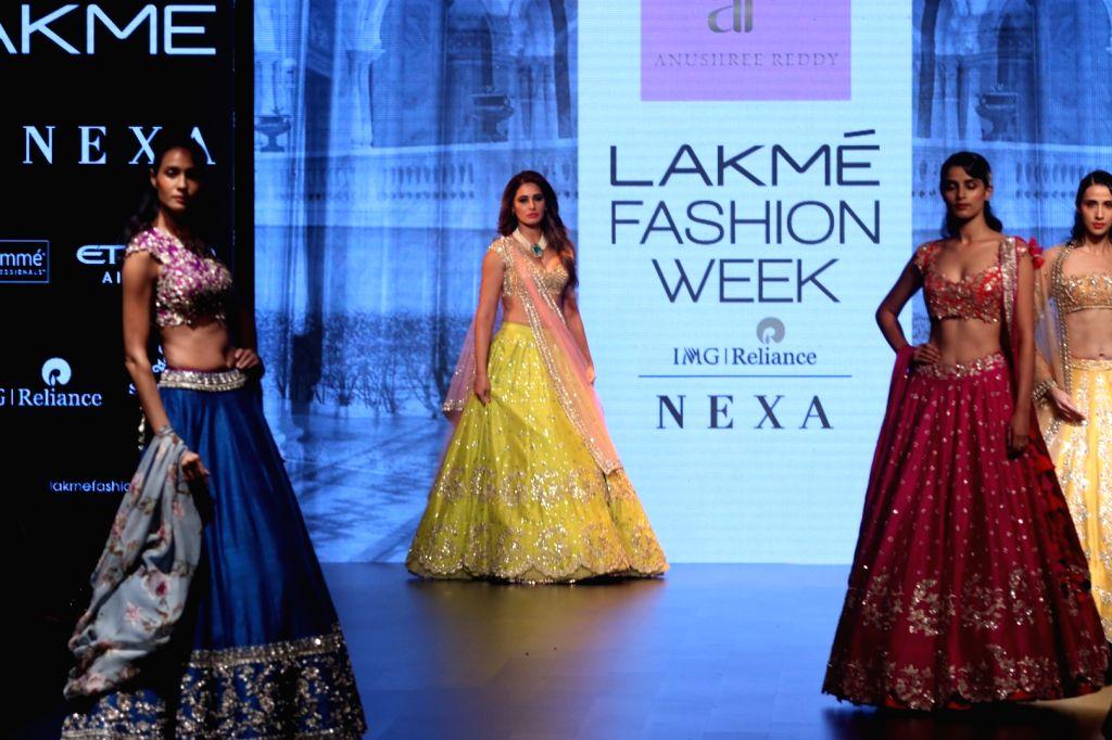 Actress Nargis Fakhri walks the ramp for fashion designer Anushree Reddy during the Lakme Fashion Week Winter/Festive 2017 in Mumbai on Aug 19, 2017. - Nargis Fakhri and Anushree Reddy