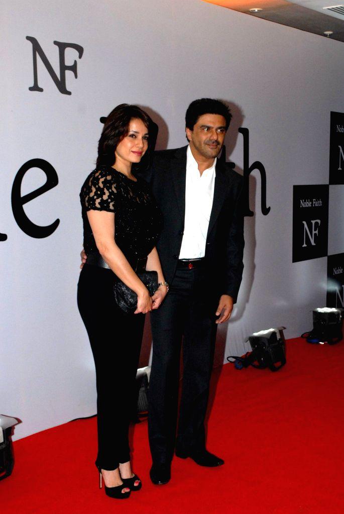 Actress Neelam Kothari with husband Samir Soni during the launch of the brand Noble Faith in Mumbai on Aug 14, 2014. - Neelam Kothari