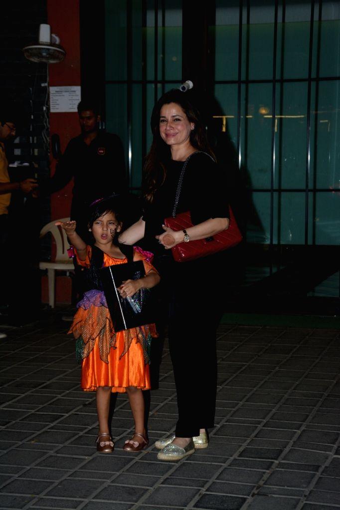 Actress Neelam with her daughter seen at Arpita Khan's Halloween party in Mumbai on Oct 31, 2018. - Neelam and Arpita Khan