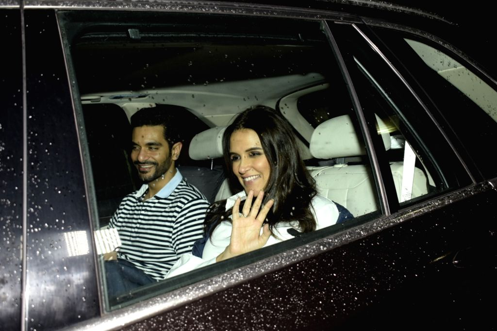 "Actress Neha Dhupia along with her husband Angad Bedi at the special screening of upcoming film ""Dhadak"" in Mumbai on July 18, 2018. - Neha Dhupia and Angad Bedi"