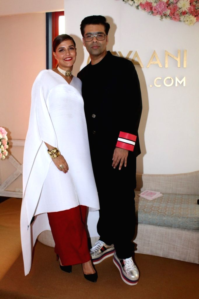 Actress Neha Dhupia and Director Karan Johar during the launch of Tyaani Flagship Polki Jewellery store in Mumbai on Oct 3, 2017. - Neha Dhupia and Karan Johar