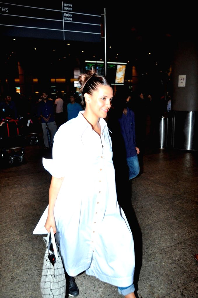 Actress Neha Dhupia at the Chhatrapati Shivaji International Airport, in Mumbai, on June 27, 2016. Actor arrived after attending the International Indian Film Academy (IIFA) Awards, which ... - Neha Dhupia