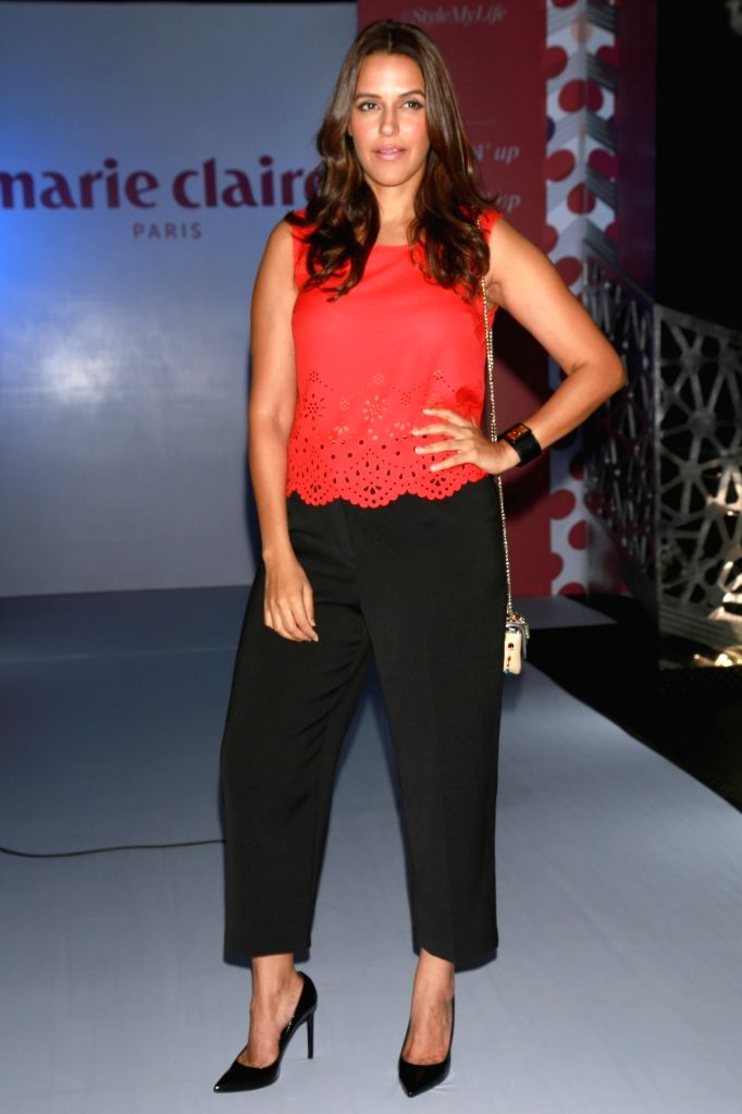 Actress Neha Dhupia at the India launch of the international premium French lifestyle brand Marie Claire in New Delhi on June 22, 2016. - Neha Dhupia