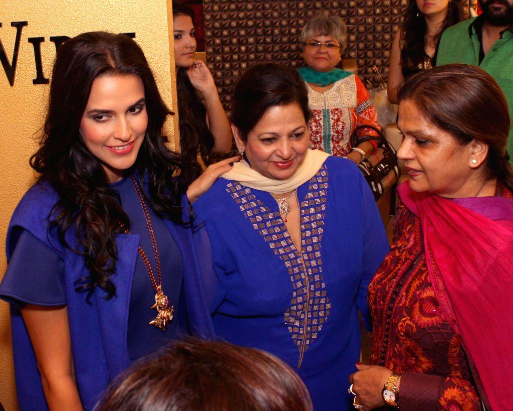 Actress Neha Dhupia during the launch of Guneet Virdi's skin care and make up studio in New Delhi on Novr 18, 2014. - Neha Dhupia