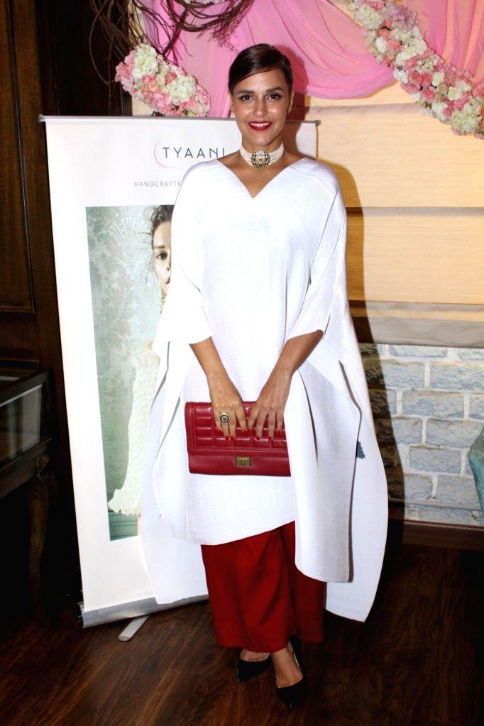 Actress Neha Dhupia during the launch of Tyaani Flagship Polki Jewellery store in Mumbai on Oct 3, 2017. - Neha Dhupia