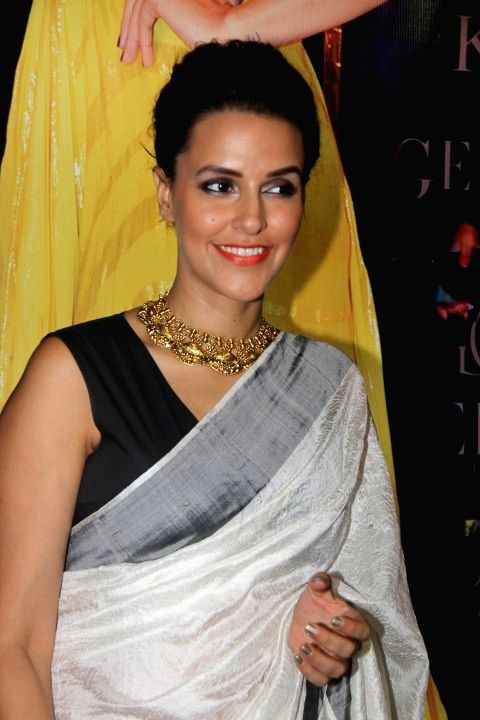 Actress Neha Dhupia during the preview of Miraki collection by Shaheen Abbas for Gehna Jewellers in Mumbai, on Nov 24, 2015. - Neha Dhupia