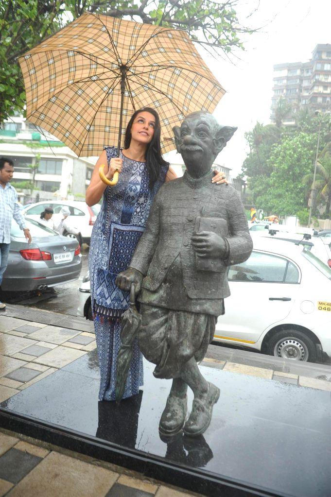 Actress Neha Dhupia during the promotion of film Ekkees Toppon Ki Salaami in Mumbai on Sept 9, 2014. The Team of Ekkees Toppon Ki Salaami paid a tribute to R. K. Laxman's Common Man Statue which has . - Neha Dhupia