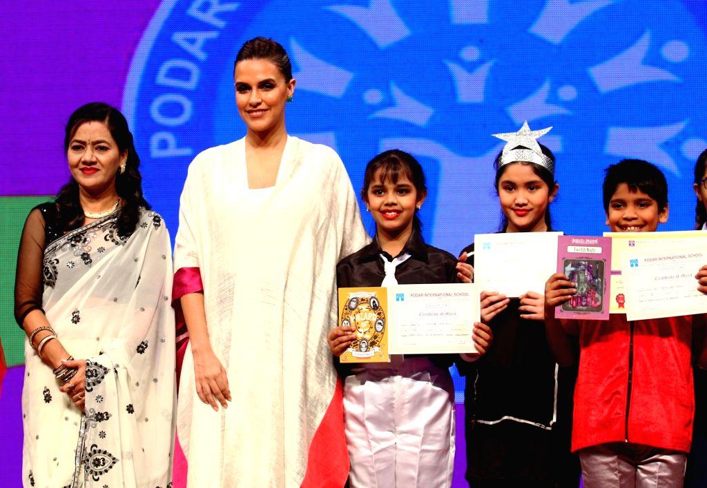 Actress Neha Dhupia felicitates students achievers of Podar International School on Oct 27, 2016. - Neha Dhupia