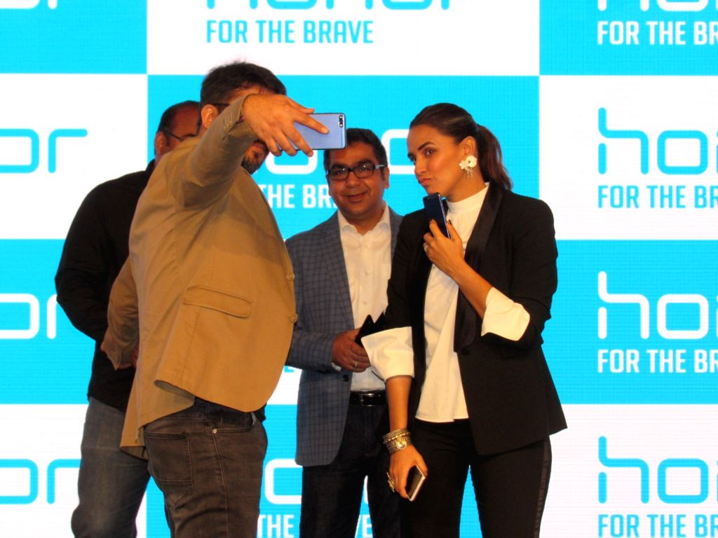 Actress Neha Dhupia poses for selfies at the launch of Huawei Honor 7A and Honor 7C smartphones, in New Delhi on May 22, 2018. (Photo: IANS) - Neha Dhupia