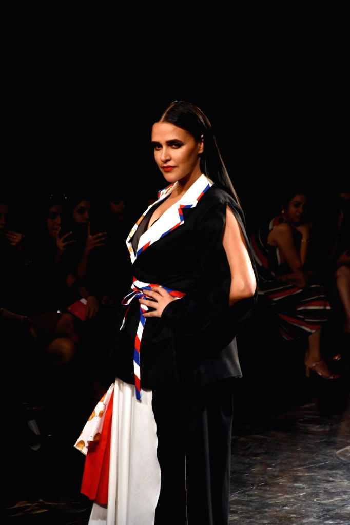 Actress Neha Dhupia showcases the creation of fashion designer Itishree Satpathy on Day 2 of the Lakme Fashion Week Summer/Resort 2020, in Mumbai on Feb 12, 2020. - Neha Dhupia