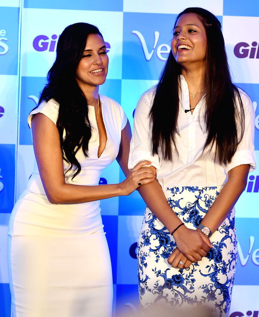 Actress Neha Dhupia with Indian squash player Dipika Pallikal during a programme in Chennai on Aug 6, 2014.