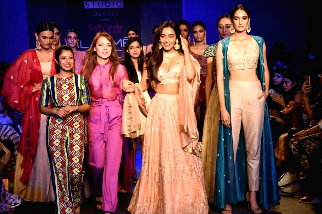 Actress Neha Sharma walks the ramp for brand 'Kraft Corridor' at the Lakme Fashion Week Winter/Festive 2019 in Mumbai on Aug 25, 2019. - Neha Sharma