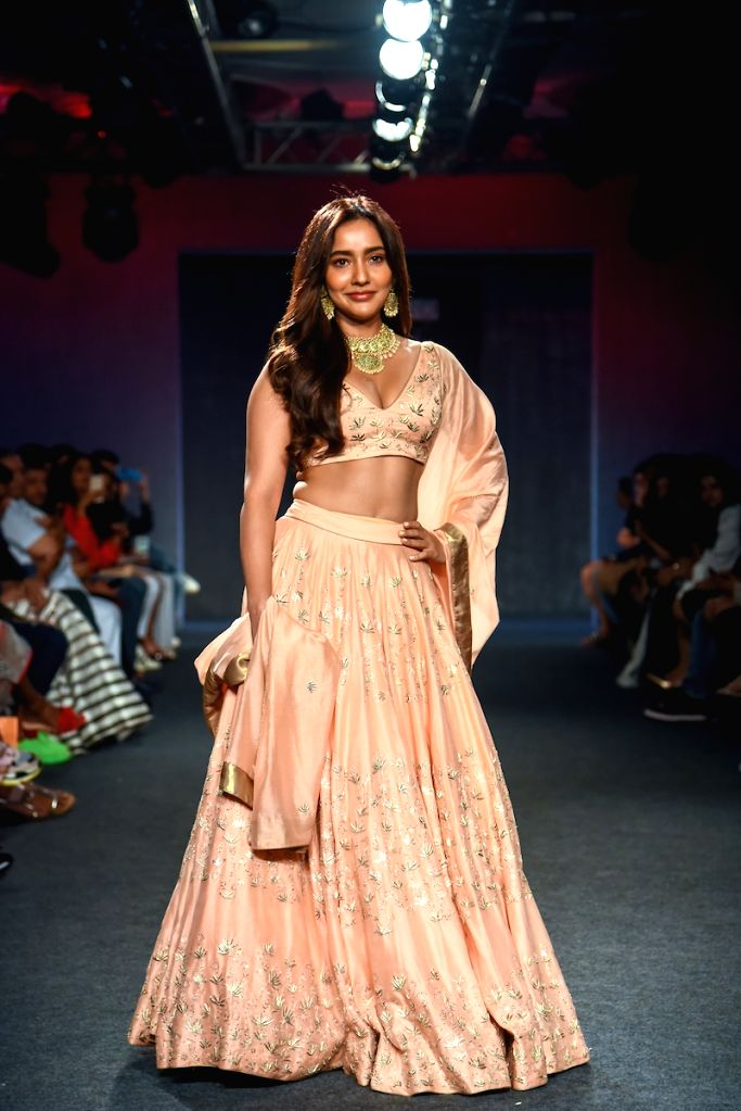 Actress Neha Sharma walks the ramp showcasing the collection of kraftcorridor on Day 5 of the Lakme Fashion Week Winter/Festive 2019 in Mumbai on Aug 25, 2019. - Neha Sharma