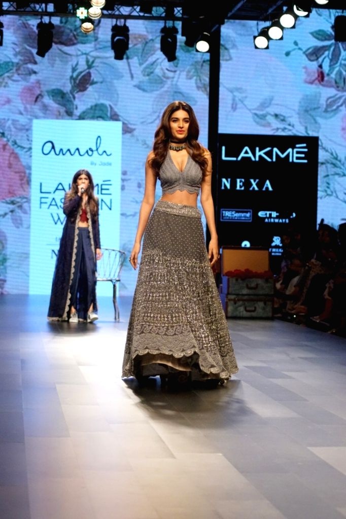 Actress Nidhhi Agerwal display the creation of fashion designer Amoh By Jade during the Lakme Fashion Week Winter/Festive 2017 in Mumbai on Aug 20, 2017. - Nidhhi Agerwal