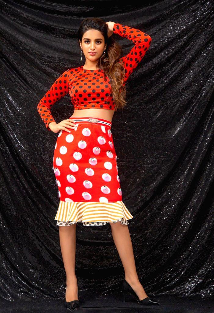Actress Nidhhi Agerwal during a photo shoot in Mumbai on Aug 2, 2019. - Nidhhi Agerwal