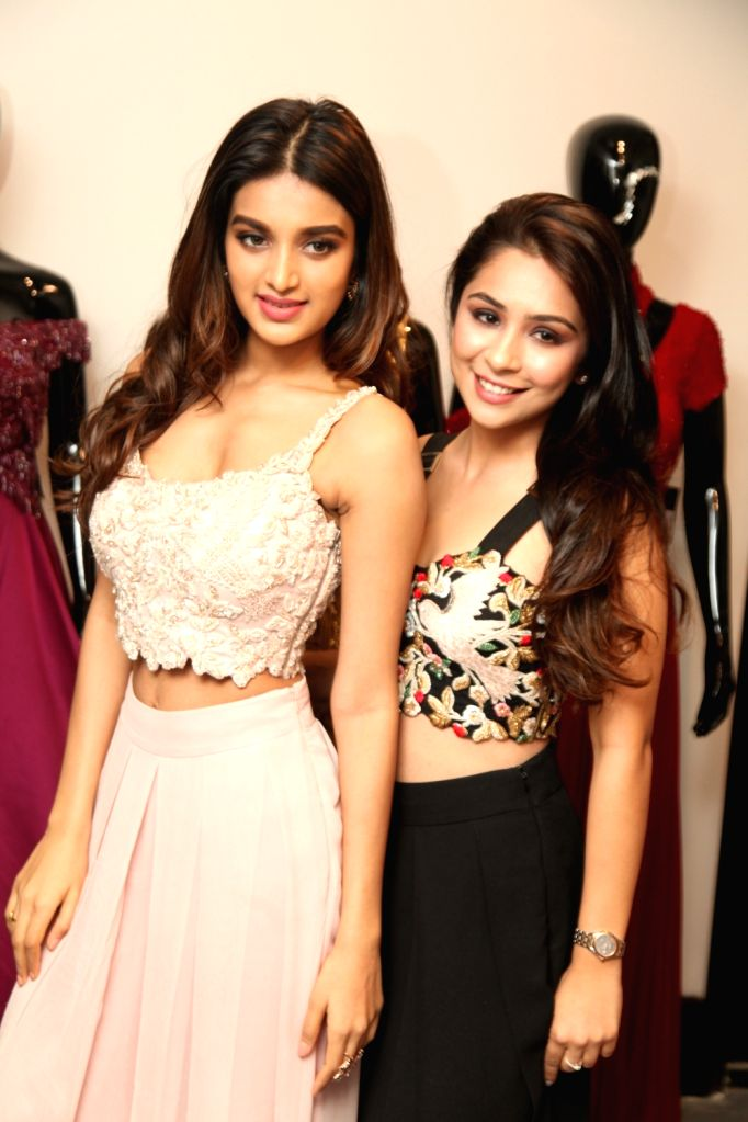 Actress Nidhhi Agerwal during the launch of a store in New Delhi on Sept 26, 2017. - Nidhhi Agerwal
