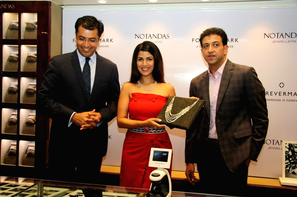 Actress Nimrat Kaur during the launch of exquisite diamond jewellery in Mumbai on Oct 25, 2016. - Nimrat Kaur