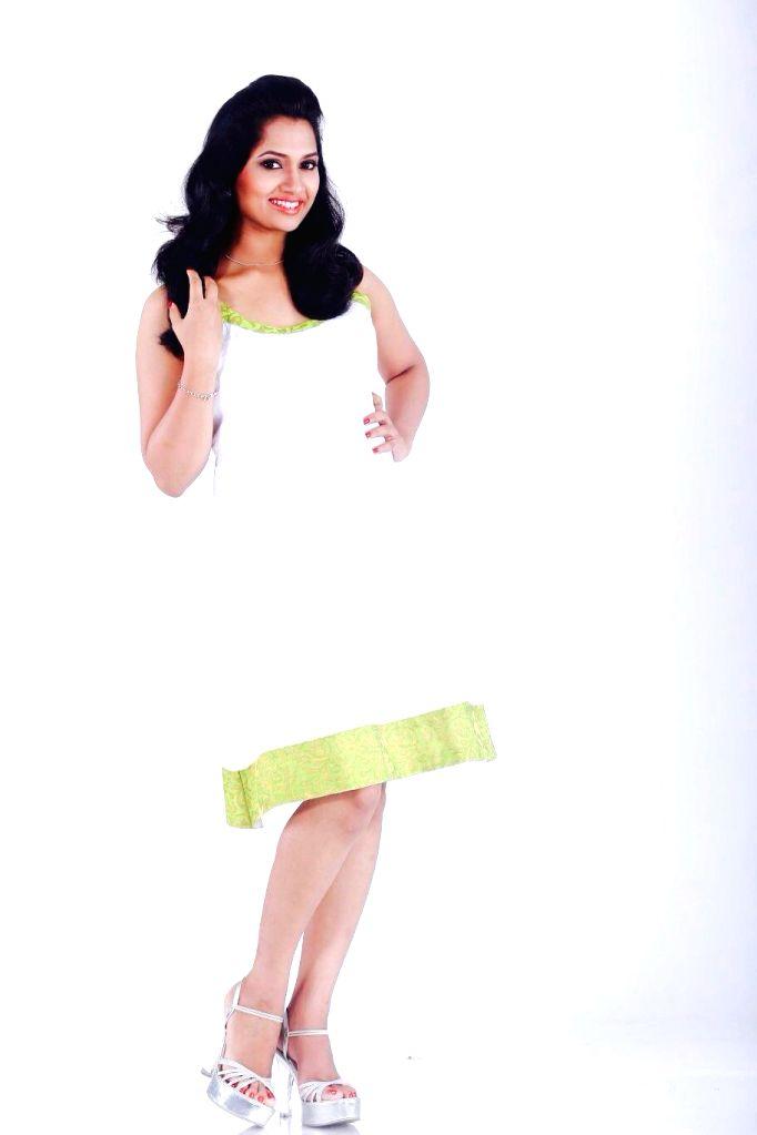 Actress Niranjana poses for a photograph during a photoshoot.