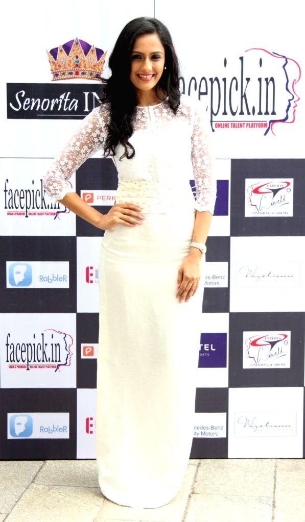 Actress Niyati Joshi during the unveiling of the Glamorous Crowns of 'Senorita India 2016' Beauty Pageant in Mumbai on Sept 8, 2016. - Niyati Joshi