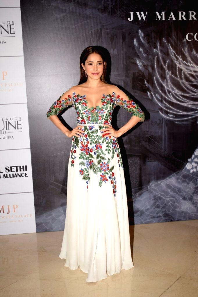 Actress Nushrat Bharucha at the red carpet of fashion designer Manish Malhotra's haute couture show, in Mumbai on Aug 1, 2018. - Nushrat Bharucha and Manish Malhotra