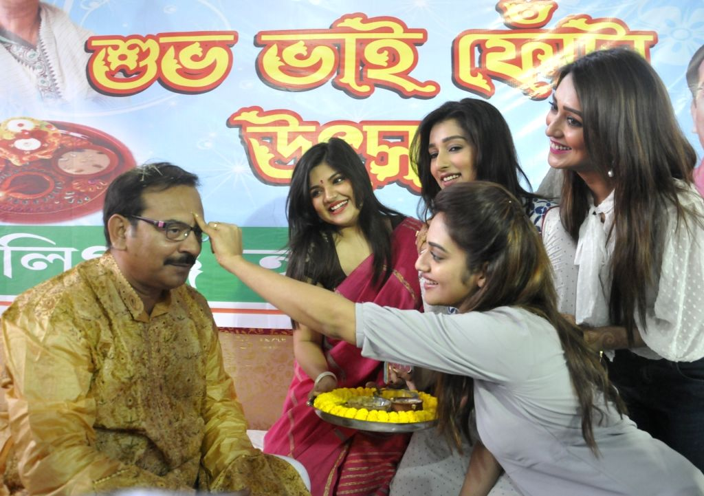 Actress Nusrat Jahan applies sandalwood paste on the forehead of West Bengal Minister Arup Biswas on Bhai Phonta - a Hindu festival where the sisters pray for safety, well being and success ... - Nusrat Jahan