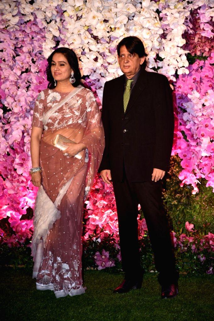 Actress Padmini Kolhapure at the wedding reception of Akash Ambani and Shloka Mehta in Mumbai on March 10, 2019. - Padmini Kolhapure, Akash Ambani and Shloka Mehta