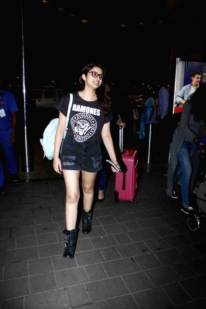 Actress Parineeti Chopra leaves for New York from Mumbai International Airport, in Mumbai,on Aug 11, 2015.