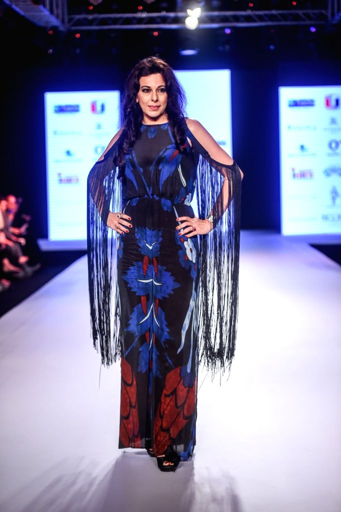 Actress Pooja Bedi walks the ramp showcasing designers Rina Dhaka and Poonam Soni's creation on the second day of Bombay Times Fashion Week 2018, in Mumbai on March 31, 2018. - Pooja Bedi