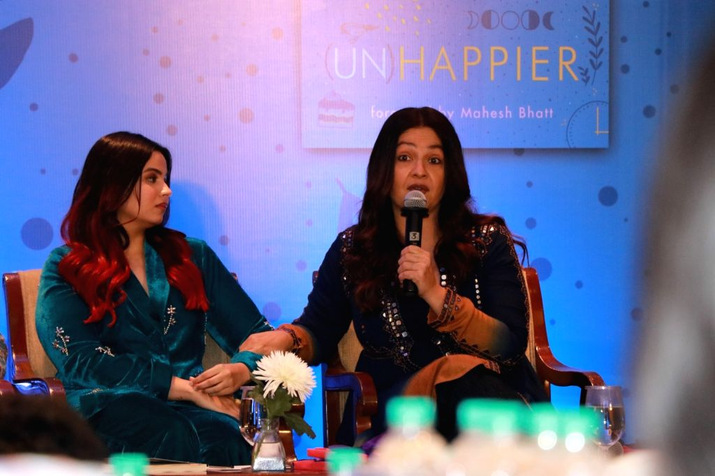 "Actress Pooja Bhatt accompanied by her sister Shaheen Bhatt addresses at the launch of latter's book ""I've Never Been (un)Happier"" in Mumbai on Dec 4, 2019. - Pooja Bhatt"