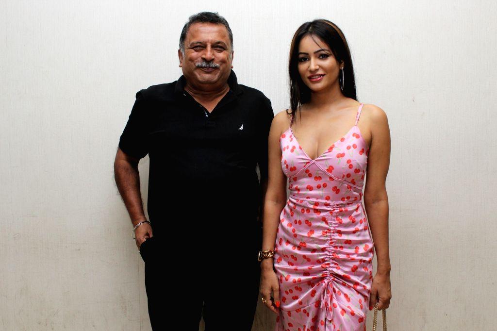 "Actress Pooja Bisht and filmmaker Ravindra Jeet Dariya at the song launch of their upcoming film ""Mushkil: Fear Behind You"" in Mumbai on July 18, 2019. - Pooja Bisht"