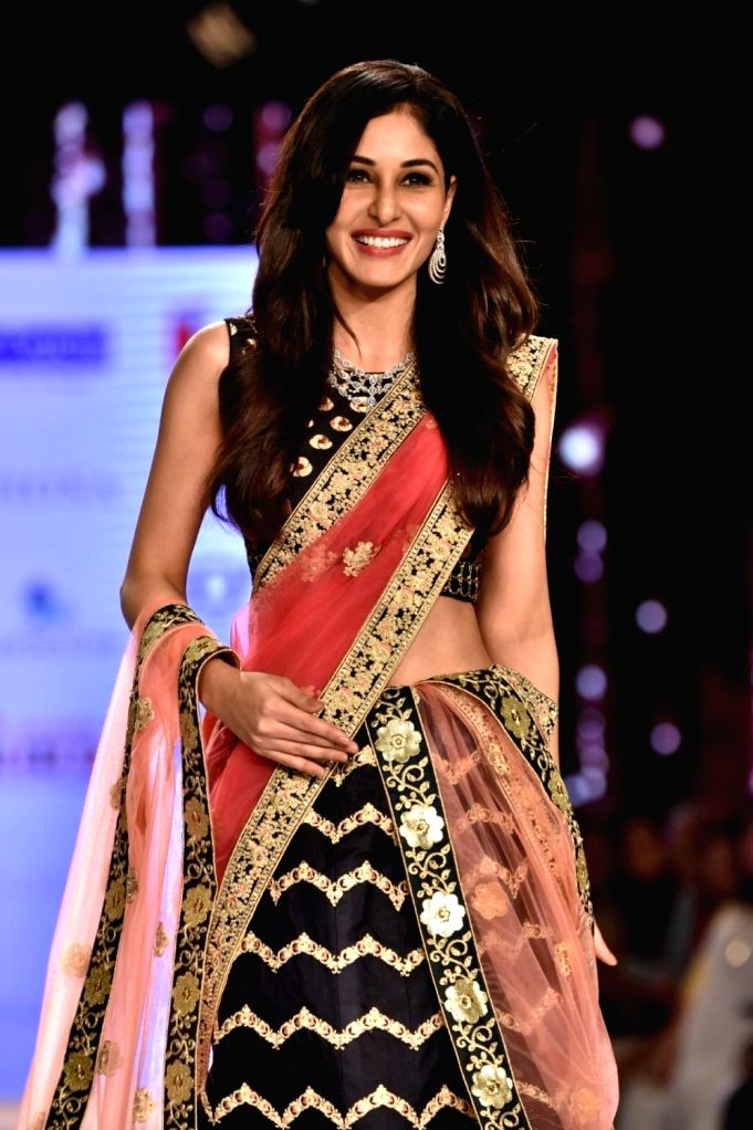 Actress Pooja Chopra showcases creations of fashion designer Shaina NC at Bombay Times Fashion Week 2018 in New Delhi, on March 30, 2018. - Pooja Chopra