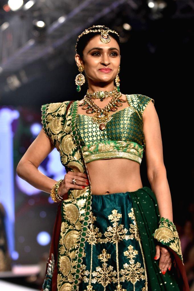 Actress Pooja Chopra showcases creations of fashion designer Shaina NC at Bombay Times Fashion Week 2018 in Mumbai, on March 30, 2018. - Pooja Chopra