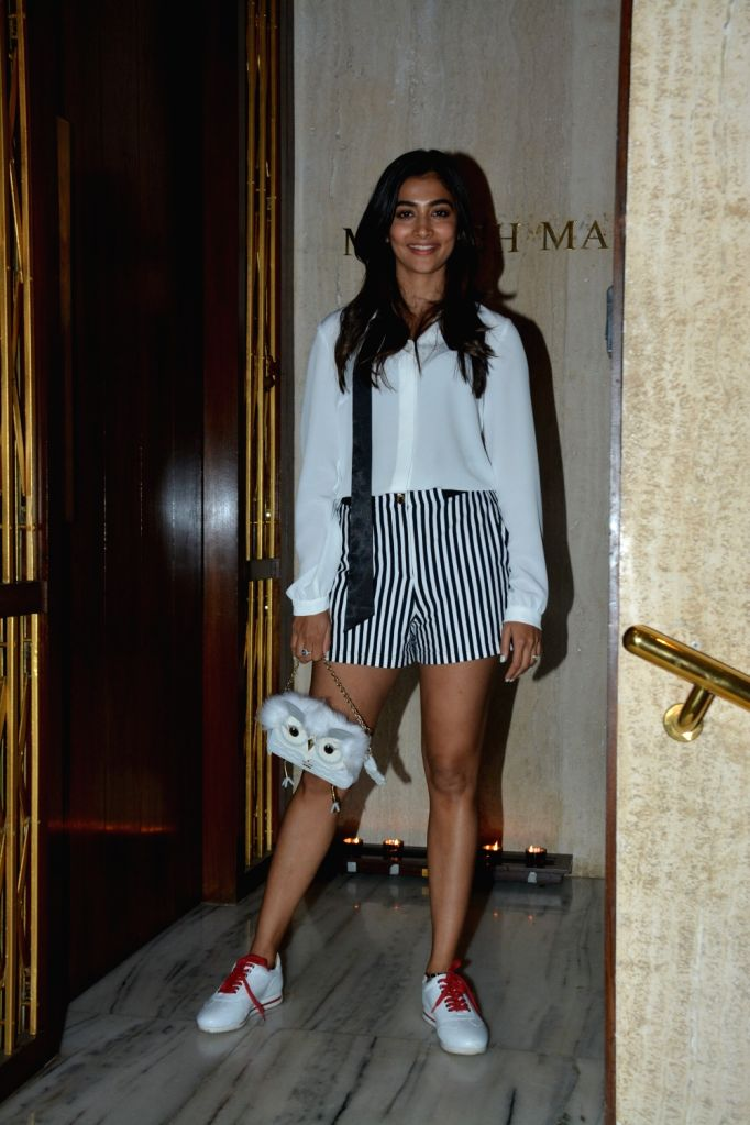 Actress Pooja Hegde at a house party hosted by fashion designer Manish Malhotra in Mumbai, on March 13, 2019. - Pooja Hegde and Manish Malhotra