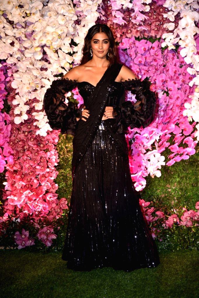 Actress Pooja Hegde at the wedding reception of Akash Ambani and Shloka Mehta in Mumbai on March 10, 2019. - Pooja Hegde, Akash Ambani and Shloka Mehta