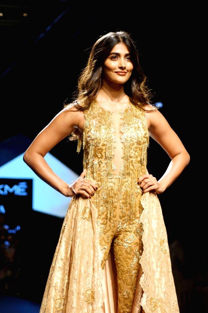 Actress Pooja Hegde displays the creation of fashion designer Sonaakshi Raaj during the Lakme Fashion Week Winter/Festive 2017 in Mumbai on Aug 20, 2017. - Pooja Hegde