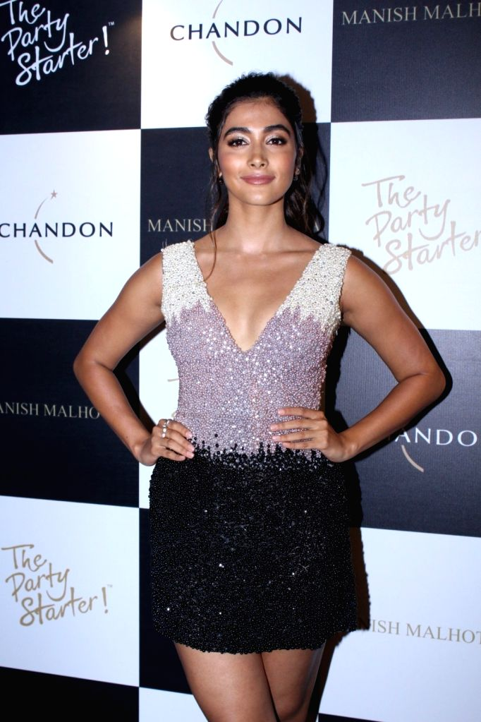 Actress Pooja Hegde during the launch of Manish Malhotra X Chandon Champagne bottles Limited Edition End Of Year 2017 in Mumbai on Oct 9, 2017. - Pooja Hegde