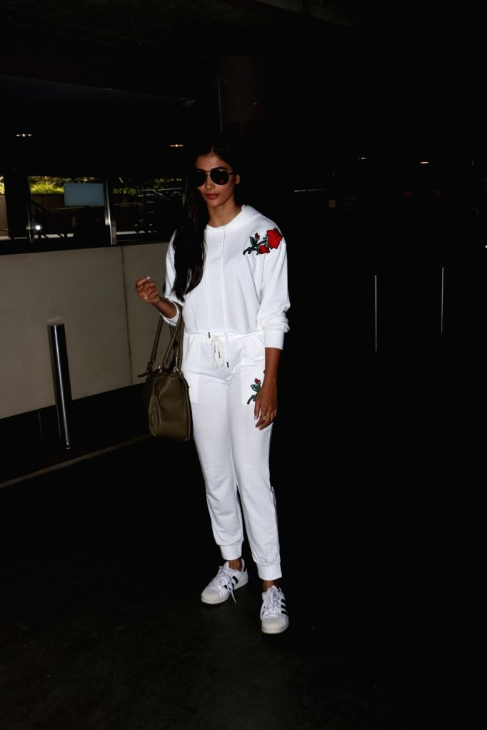 Actress Pooja Hegde seen at Chhatrapati Shivaji Maharaj International airport in Mumbai. - Pooja Hegde