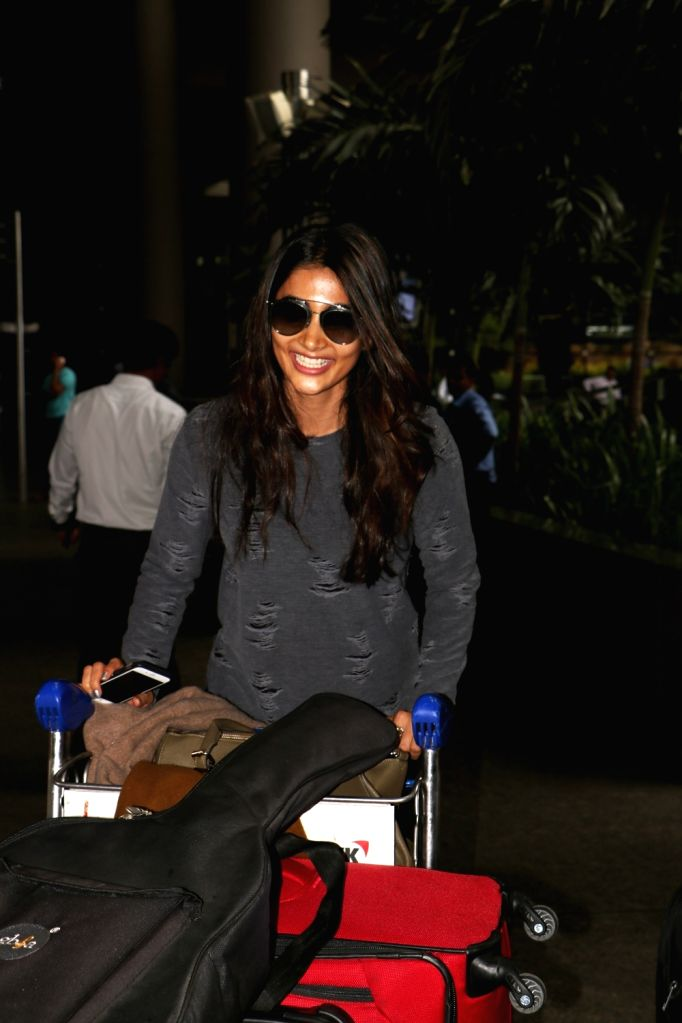 Actress Pooja Hegde spotted at airport in Mumbai,on June 12, 2017. - Pooja Hegde