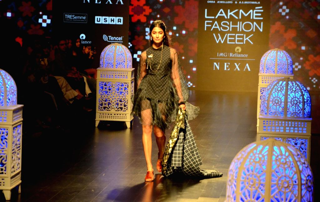 Actress Pooja Hegde walks the ramp in fashion designers Saaksha and Kinni's creation at Lakme Fashion Week (LFW) Summer/Resort 2019 in Mumbai, on Feb 2, 2019. - Pooja Hegde