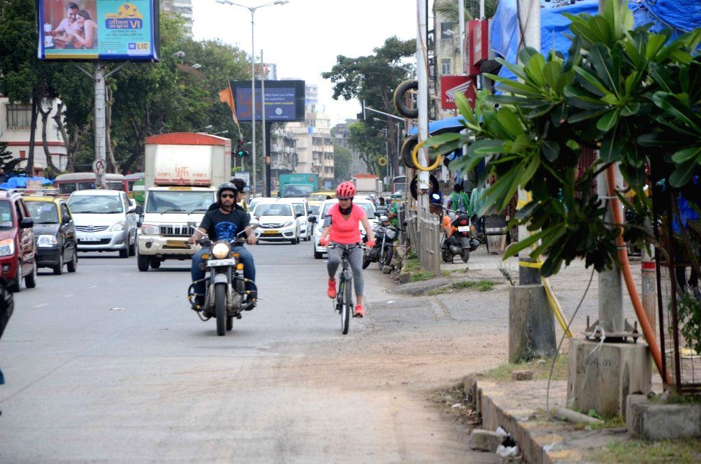 Actress Pooja Ketan Naik rides a cycle from Nariman point to Dahisar to spread awareness regarding prevention acid attacks in Mumbai on Sept 5, 2018. - Pooja Ketan Naik
